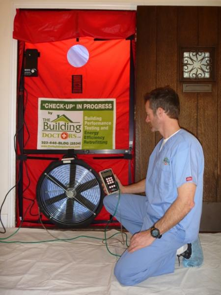 An energy doctor performing a blower door test