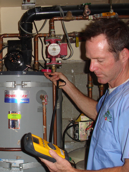 An Energy Doctor checking a water heater in a customer home