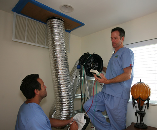 The Build Doctor's team performing a Duct Blaster test at a job site