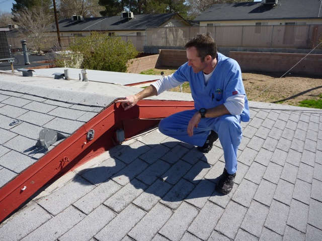 Inspecting a customer's roof
