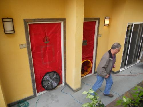 A  blower door test being performed at a multi-family residence
